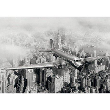 Avión Volando sobre el Nueva York Años 50