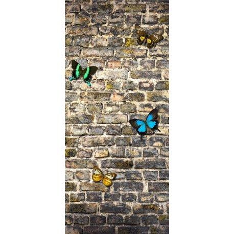 Muro de Ladrillos con Mariposas de Color
